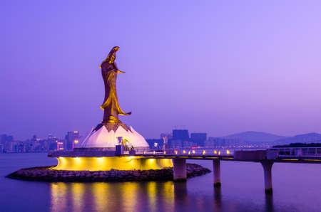Statue of Kun Iam in the evening, the goddess of mercy, landmark of Macau