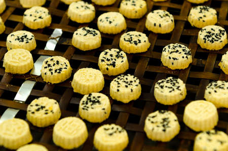 almond biscuit: Almond biscuit and biscuit making process in background