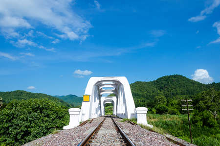 lamphun: Old white railway bridge constructed against a blue sky in Lamphun, Thailand