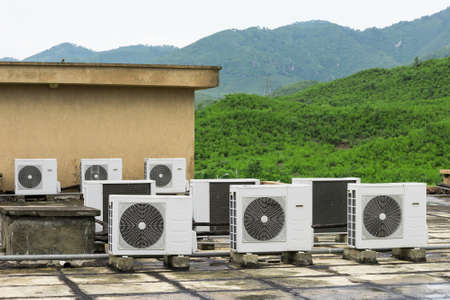 coolant temperature: Air conditioning compressors assembled on a building