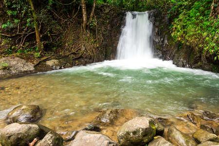 kaeng: Tropical rainforest landscape with beautiful waterfall, rocks and jungle plants. Vang Vieng, Laos (kaeng nyui waterfall) Stock Photo