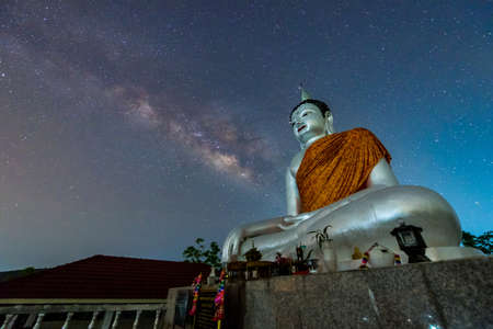 Buddha statue on the milky way background in Thailand photo