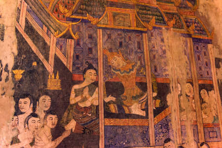 Ancient Buddhist temple the famous mural painting at Wat Phumin, a famous temple in Nan province,Thailand. The temple is open to the public. Editorial