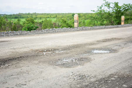 stone road: rough bumpy stone road in rural Stock Photo