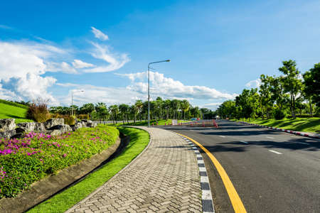 vacant lot: Roadside view of beautiful park on blue sky