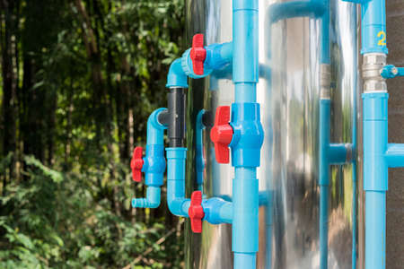 Water valve connects to PVC pipe. Stock Photo
