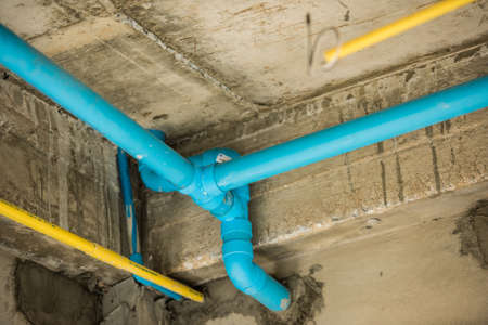 Blue PVC pipe under the structure house