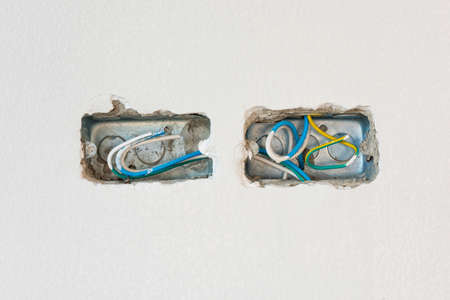 power cables: Wire box with different colored cables for power outlet installation.