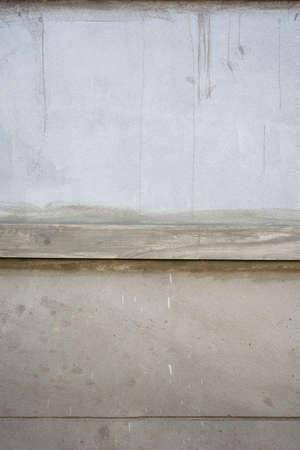 plasterer: plasterer concrete worker at wall is under development Stock Photo