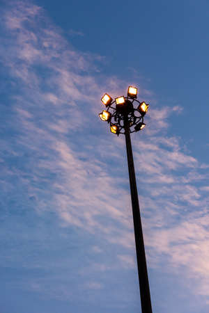 electric avenue: street lamp against  sky in evening.