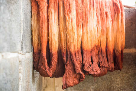 cotton thread: Dyeing silk, Using traditional natural materials, Raw multicolored cotton thread Stock Photo