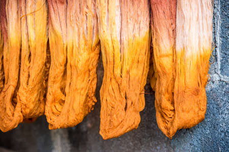 natural materials: Dyeing silk, Using traditional natural materials, Raw multicolored cotton thread Stock Photo