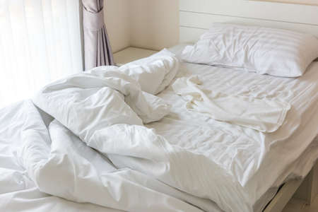 messy: Messy bedding sheets and pillow