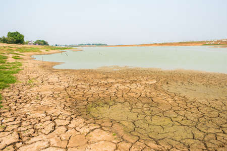 waterless: cracked soil in the bottom of a river showing drought