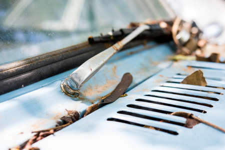 abandoned car: Rusty wipers on an old abandoned car Stock Photo