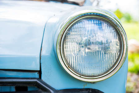 headlights: Old car with close-up on headlights Stock Photo