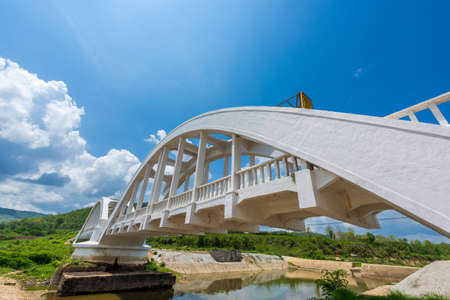 lamphun: Old white railway bridge constructed against blue sky at Lamphun, Thailand.