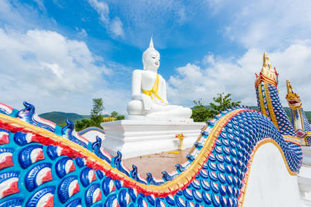mea: White Buddha statue and serpent in Wat Chom tham at mea on in chiang mai, Thailand Stock Photo