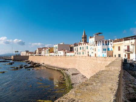 Alghero Marina and the ancient city with its walls in Sardinia, Italy.