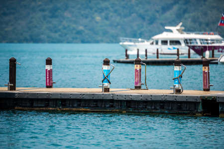 NANTOU, TAIWAN - MARCH 28 : Pier pillar for boats at the lake of famous attraction, Sun Moon Lake at Taiwan on March 28, 2017 in Nantou county, Taiwan, Asia.