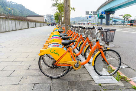 TAIPEI, TAIWAN - April 1, 2017 : Row of Ubike. Ubike is a popular network of rental bicycle in Taipei, Taiwan. Ubike is a bike sharing system service used by citizens as short-distance transit vehicles.
