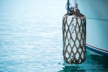 Buoys and anchor ropes. White buoys and anchor ropes on boat. Stock Photo
