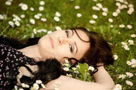 girl lying on a meadow photo
