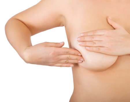 woman examining her breast for lumps photo