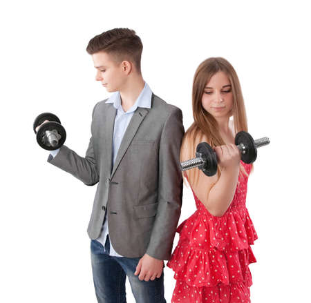 dress suit: teenage boy and girl exercising with dumbbell