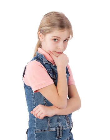 hand on the chin: young girl with hand on chin Stock Photo