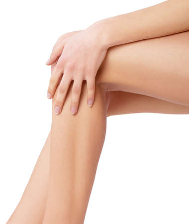 footcare: beautiful woman legs on a white background