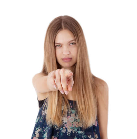 somebody: angry girl pointing her finger against somebody Stock Photo