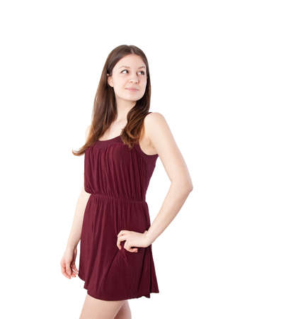 pretty dress: young beautiful teenage girl on a white background