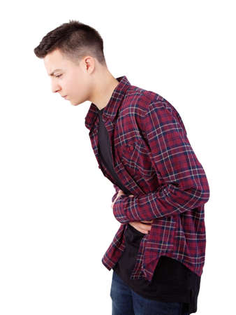 teenage boy with stomach pain Stock Photo