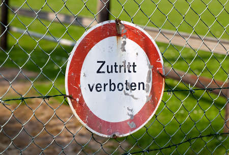 Old german sign fixed at a fence
