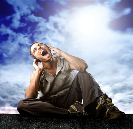 vagabond: a man singing and listen the music Stock Photo