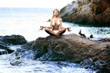 A beautiful woman in yoga position Stock Photo - 2718488