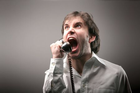 wrath: A man screaming on the phone Stock Photo