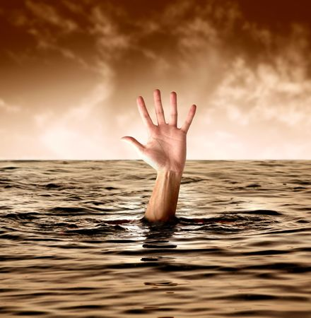 drowning: a hand in the sea
