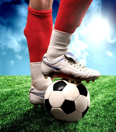 shoot: a close up of a soccer ball and a feet of a soccer player