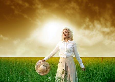 a senior woman in a grass field Stock Photo - 3019472