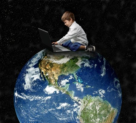 a child with a laptop on the big globe Stock Photo - 3560488