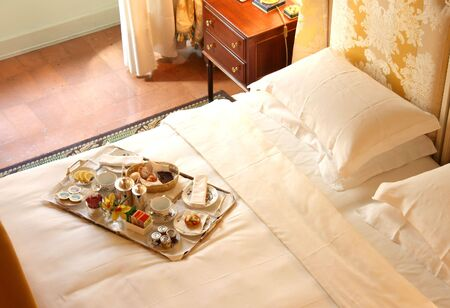 breakfast hotel: a breakfast tray on the bed