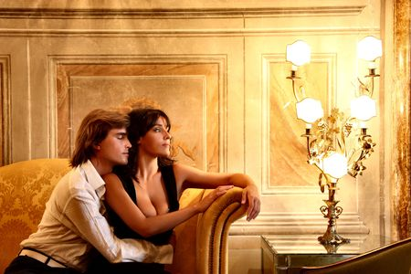 baroque room: a young couple in a luxury sitting room of hotel