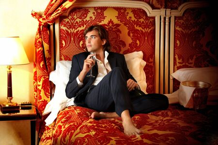 luxury bed: a man on the luxury bed Stock Photo