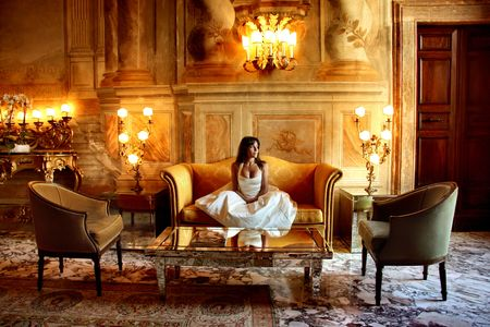 palaces: a woman in a luxury hotel