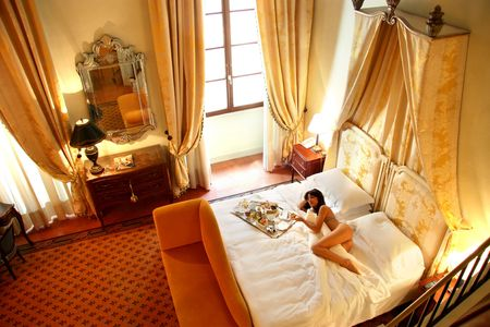 girls naked:  a beautiful woman in a room of a luxury hotel