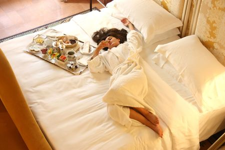 a woman on the bedroom with a breakfast