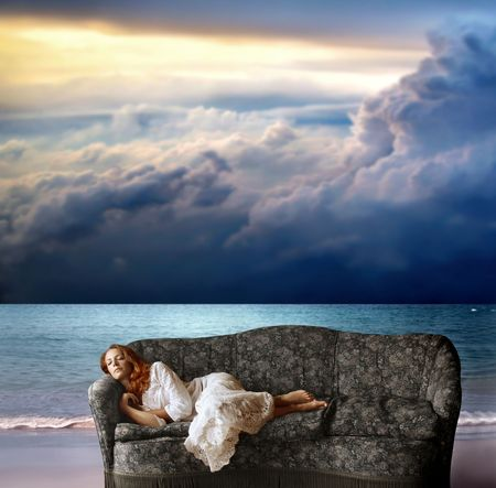 pillow sleep: a woman sleeping on the sofa on the beach