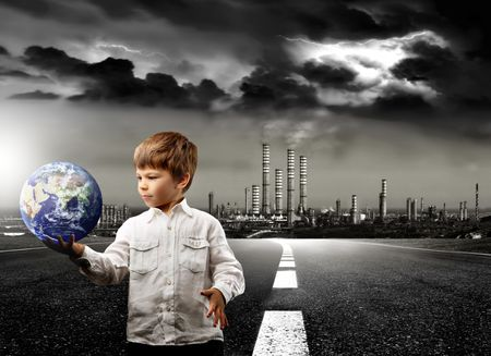 a child with a globe and a factory photo